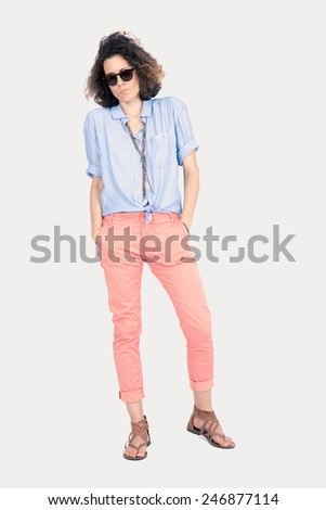 Beautiful woman doing different expressions in different sets of clothes: posing with sunglasses - stock photo