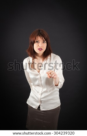Beautiful woman doing different expressions in different sets of clothes: suspicion - stock photo