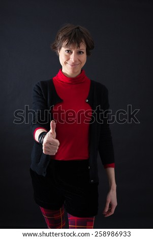 Beautiful woman doing different expressions in different sets of clothes: thumbs up