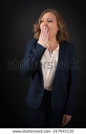 Beautiful woman doing different expressions in different sets of clothes: yawn - stock photo
