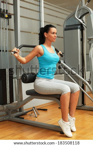 Beautiful woman doing exercise for strengthening back - stock photo