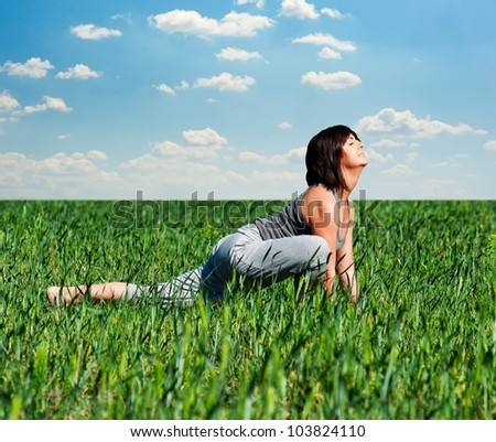 beautiful woman doing sport exercises at the field - stock photo