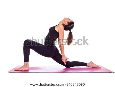 Beautiful woman doing Virabadrasana variant pose on yoga class. Studio shot. - stock photo