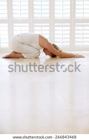 Beautiful woman doing yoga exercises  - stock photo