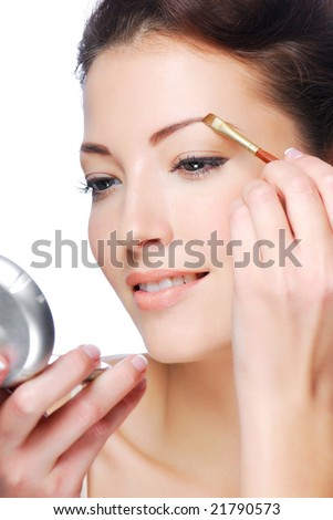 Beautiful  woman draw beauty shape of eyebrows using cosmetic brush - stock photo