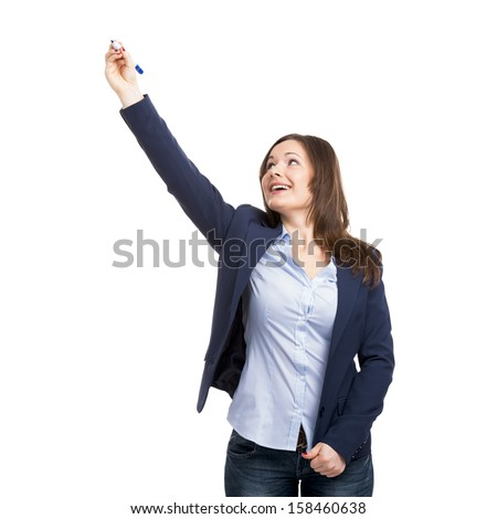 Beautiful woman drawing on a glass board, isolated over white background - stock photo