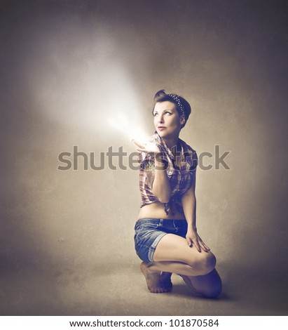 Beautiful woman dressed as a pinup - stock photo