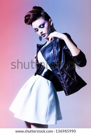 beautiful woman dressed elegant punk posing in the studio - stock photo