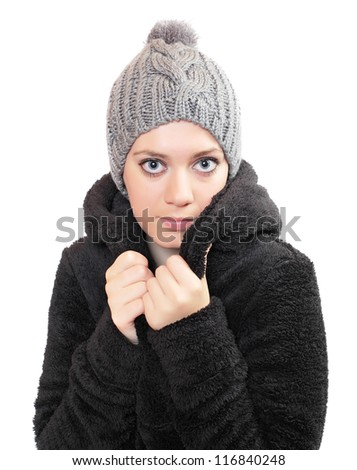 Beautiful woman dressed in fur coat and knitted hat. - stock photo