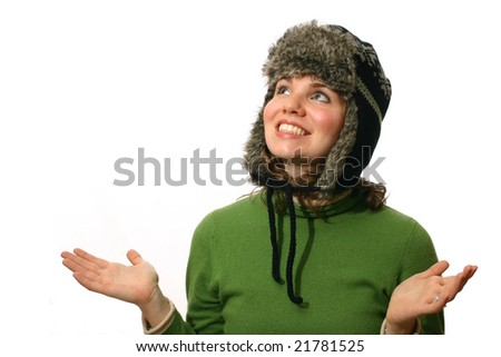 Beautiful woman dressed warmly and looking up - stock photo