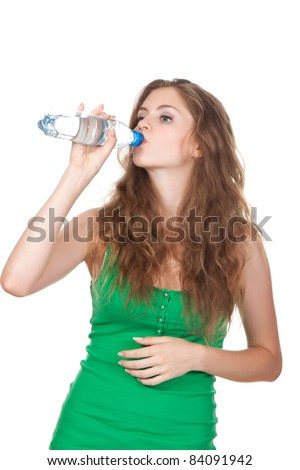 beautiful woman drink some water from plastic bottle isolated over white background - stock photo