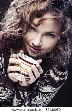 Beautiful woman drinking coffee - stock photo