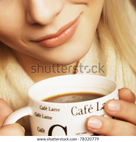 Beautiful woman drinking coffee. studio shot. - stock photo