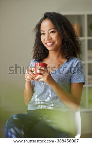 Beautiful woman drinking tea or coffee at home
