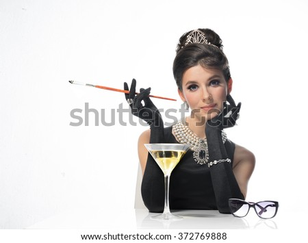 Beautiful woman drinks alcohol and nicotine is a very toxic - stock photo