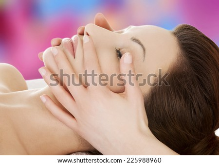 Beautiful woman during face massage
