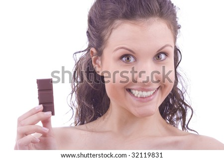 beautiful woman eat chocolates over white background
