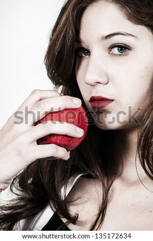 Beautiful woman eating a whole red delicious apple