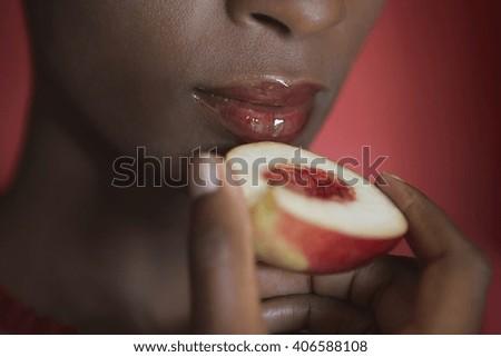 Beautiful woman eating fruit at diet. Vegan concept - stock photo