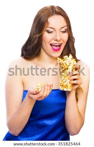 Beautiful woman eating popcorn isolated on white background - stock photo
