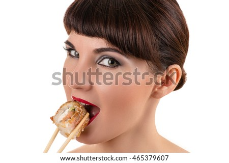 beautiful woman eating roll with salmon