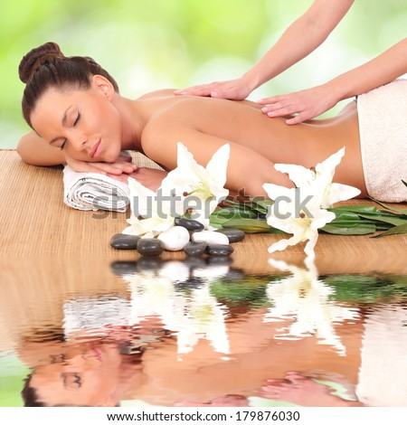 Beautiful woman enjoying a massage therapy