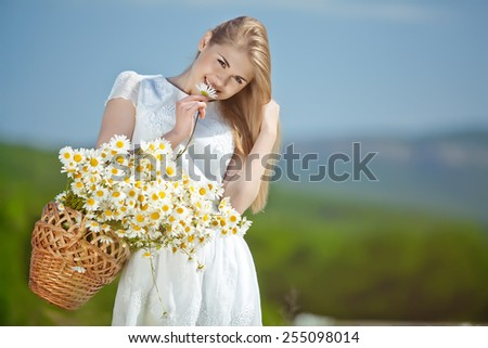 Beautiful woman enjoying daisy field, nice female down in meadow of flowers, pretty girl relaxing outdoor, having fun,  happy young lady and spring green nature, harmony concept - stock photo