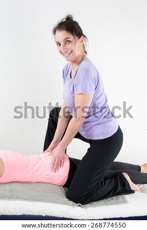 Beautiful woman enjoying massage - stock photo