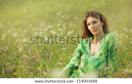Beautiful woman enjoying nature in the flowers field - stock photo