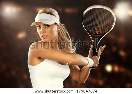 Beautiful woman enjoying the great game of tennis. Playing tennis - stock photo
