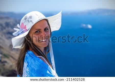 Beautiful Woman Enjoying The View Of The Wonderful Santorini, Greece - stock photo