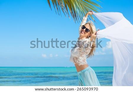 Beautiful woman enjoying vacation in tropical destination - stock photo