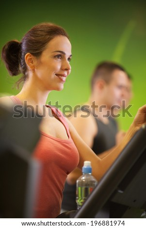 Beautiful woman exercising in a gym. - stock photo