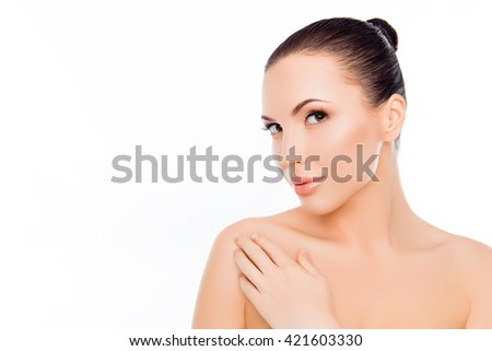 Beautiful woman expertising her skin after spa procedures - stock photo