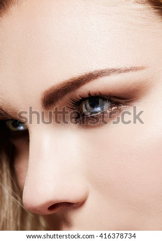 Beautiful woman eyes and eyebrows close up. Perfect skin texture around the eyes.  - stock photo
