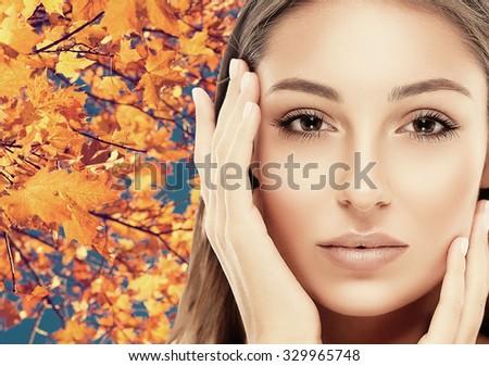 Beautiful woman face close up autumn  - stock photo