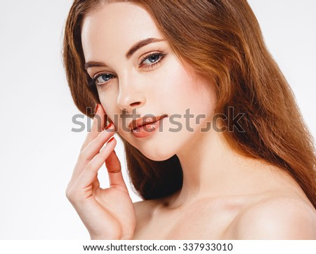 Beautiful woman face close up portrait happy studio on white    - stock photo