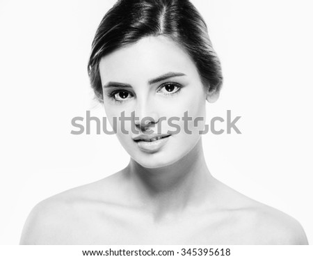 Beautiful woman face close up portrait studio on white black and white  - stock photo