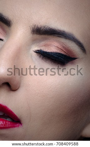 Beautiful woman face close up portrait, studio shot