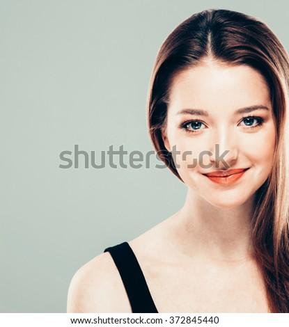 Beautiful woman face close up portrait young studio brunette - stock photo