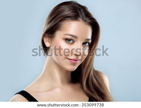 Beautiful woman face close up portrait young studio on gray  - stock photo