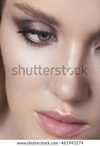 Beautiful woman face close up studio.