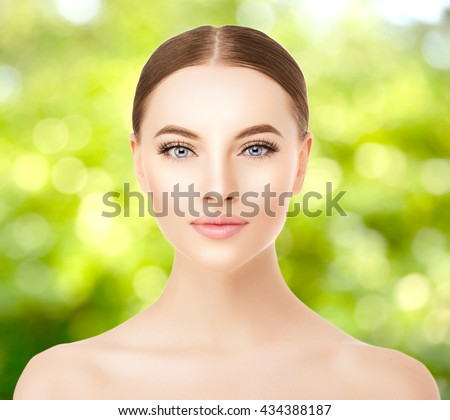 Beautiful woman face close up studio. Beauty spa model female with clean fresh skin closeup, with perfect skin. Youth fresh skin care concept. Portrait of girl looking at camera, smiling. Cosmetology.