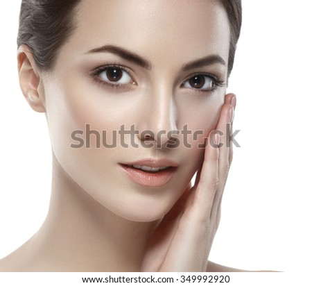 Beautiful woman face close up studio on white portrait - stock photo