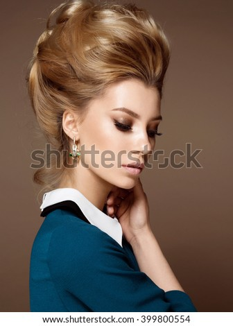 Beautiful woman face close up studio with hight hairstyle - stock photo