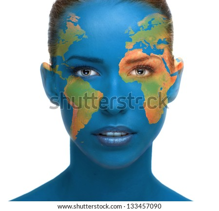 Beautiful woman face close up with planet Earth texture. Elements of this image furnished by NASA