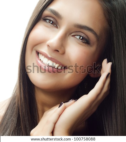 beautiful woman face closeup, portrait of attractive  caucasian smiling young girl, isolated on white studio shot . perfect skin, toothy smile, teeth, eyes, long hear, brunette, hands, close up - stock photo