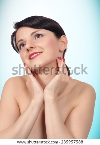 Beautiful woman face on a blue background - stock photo