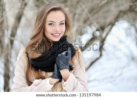 Beautiful woman face outdoor portrait - stock photo