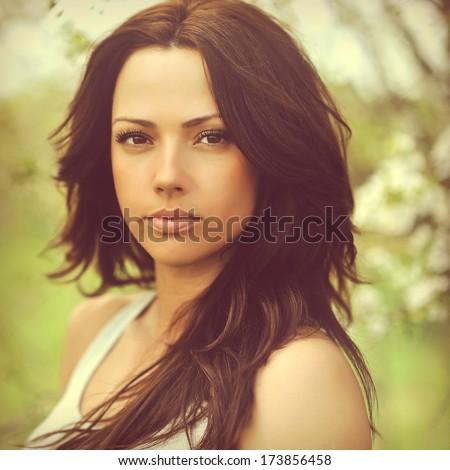 Beautiful woman face - outdoors - stock photo